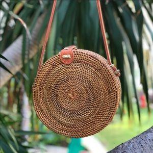 Handbags - NWOT Bali Rattan Woven Straw Round Bag